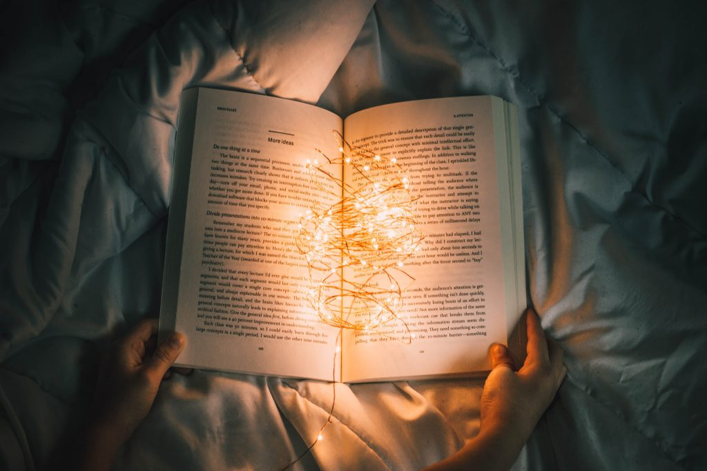 reading in bed with sparkler light