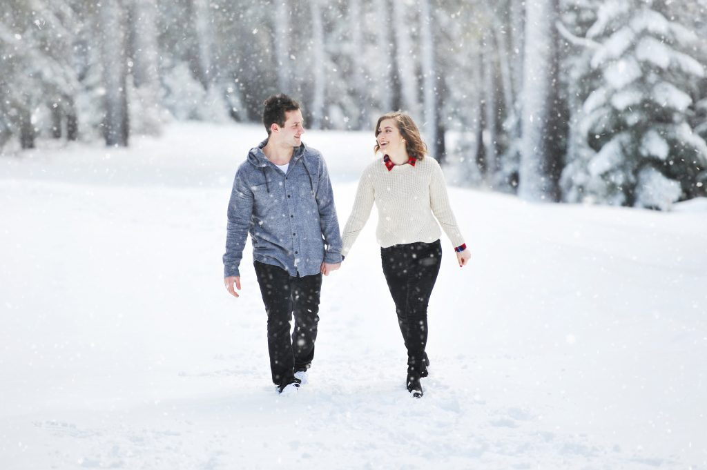 a pair walking in the snow