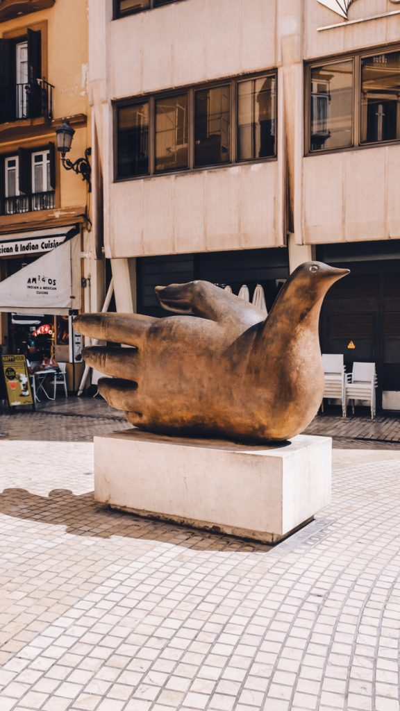 Hand and dove monument in the center of Malaga. Symbol of peace.