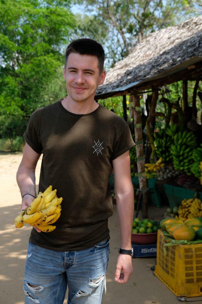 happy banana loving husband in sri lanka