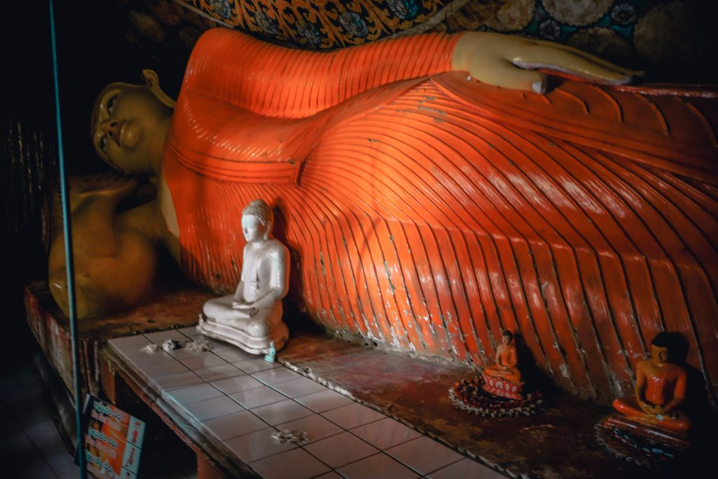 laying buddha statue in the buddhist temple at the foot of pidurangala rock