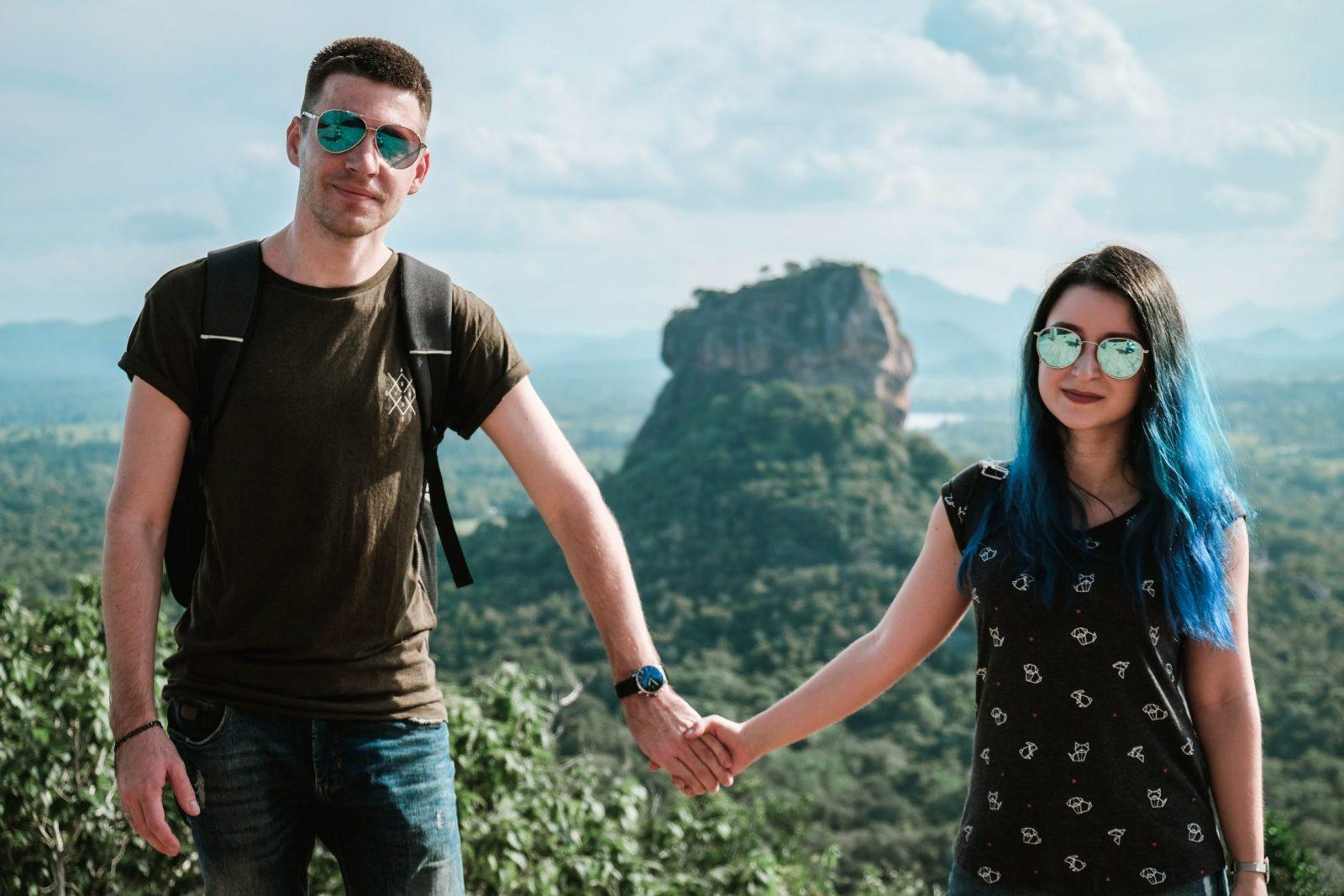 a couple holding hands at pidurangala rock sri lanka sigiriya