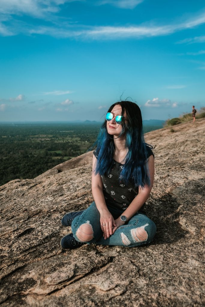 relaxing on top of pidurangala rock