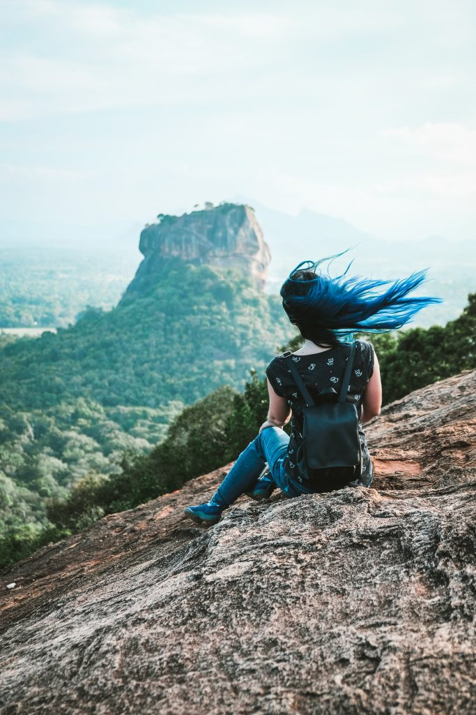 climbed the pidurangala mountain: blue hair on a windy day