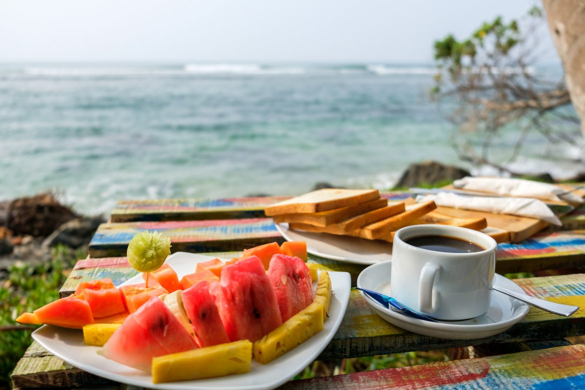 fruits and coffee breakfast near the ocean with sea view