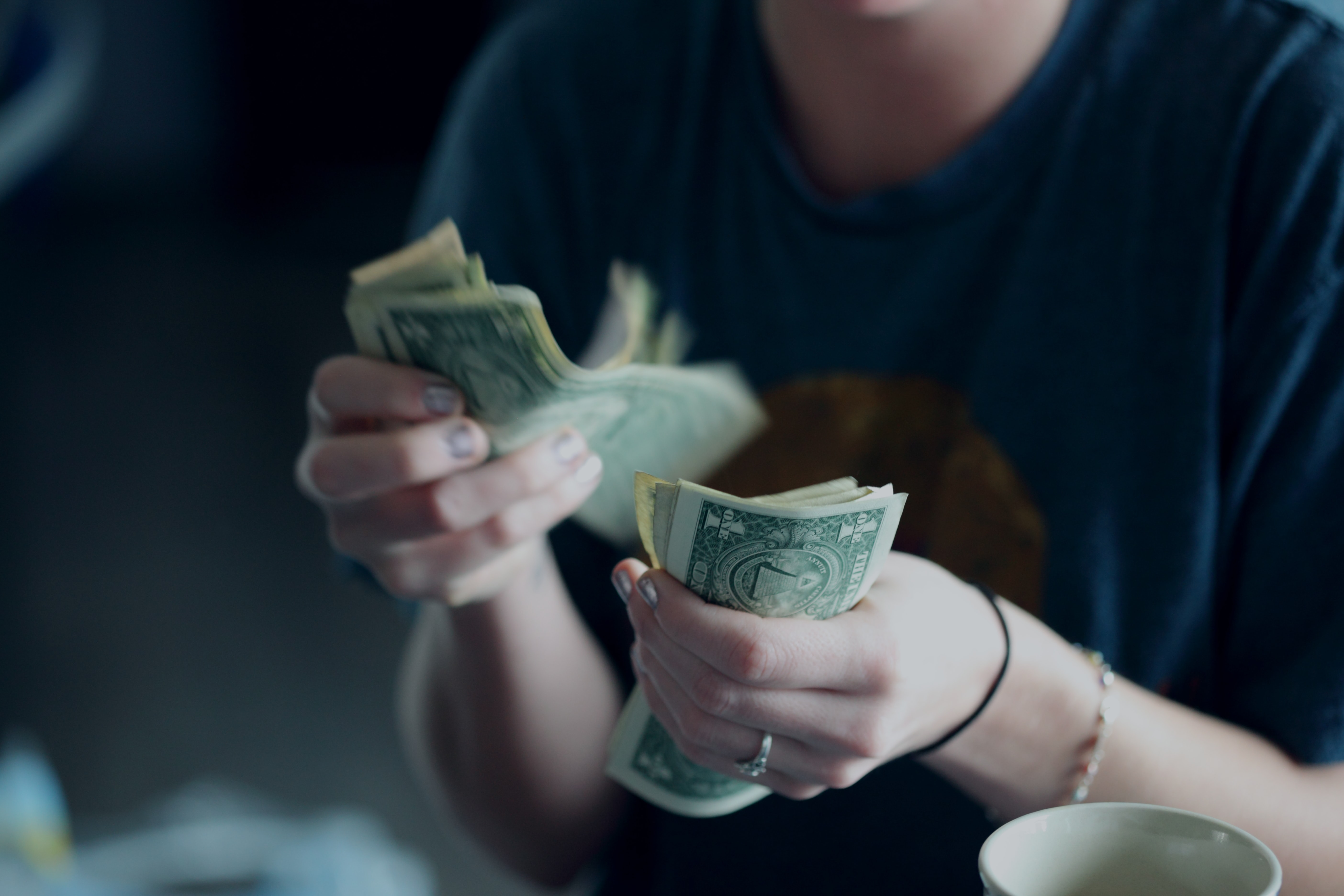 girl counting cash