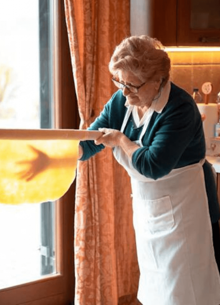 grandma making homemade pasta at a cooking class from italy