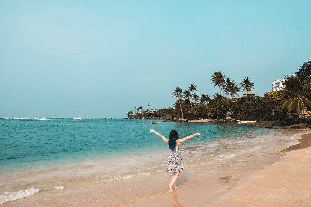 Walking at Polhena beach in Sri Lanka