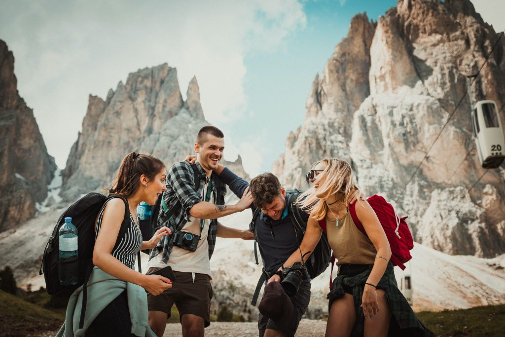 friends laughing at funny travel quotes on a trip together