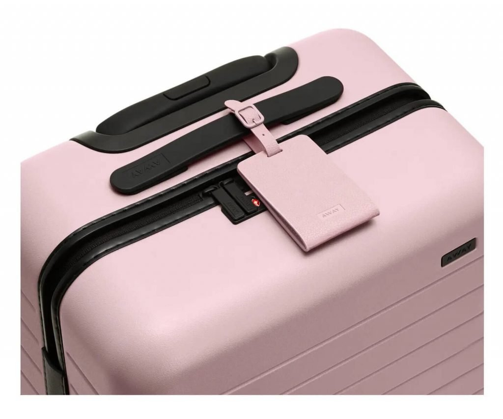 luggage tag is a must have for a traveling business woman