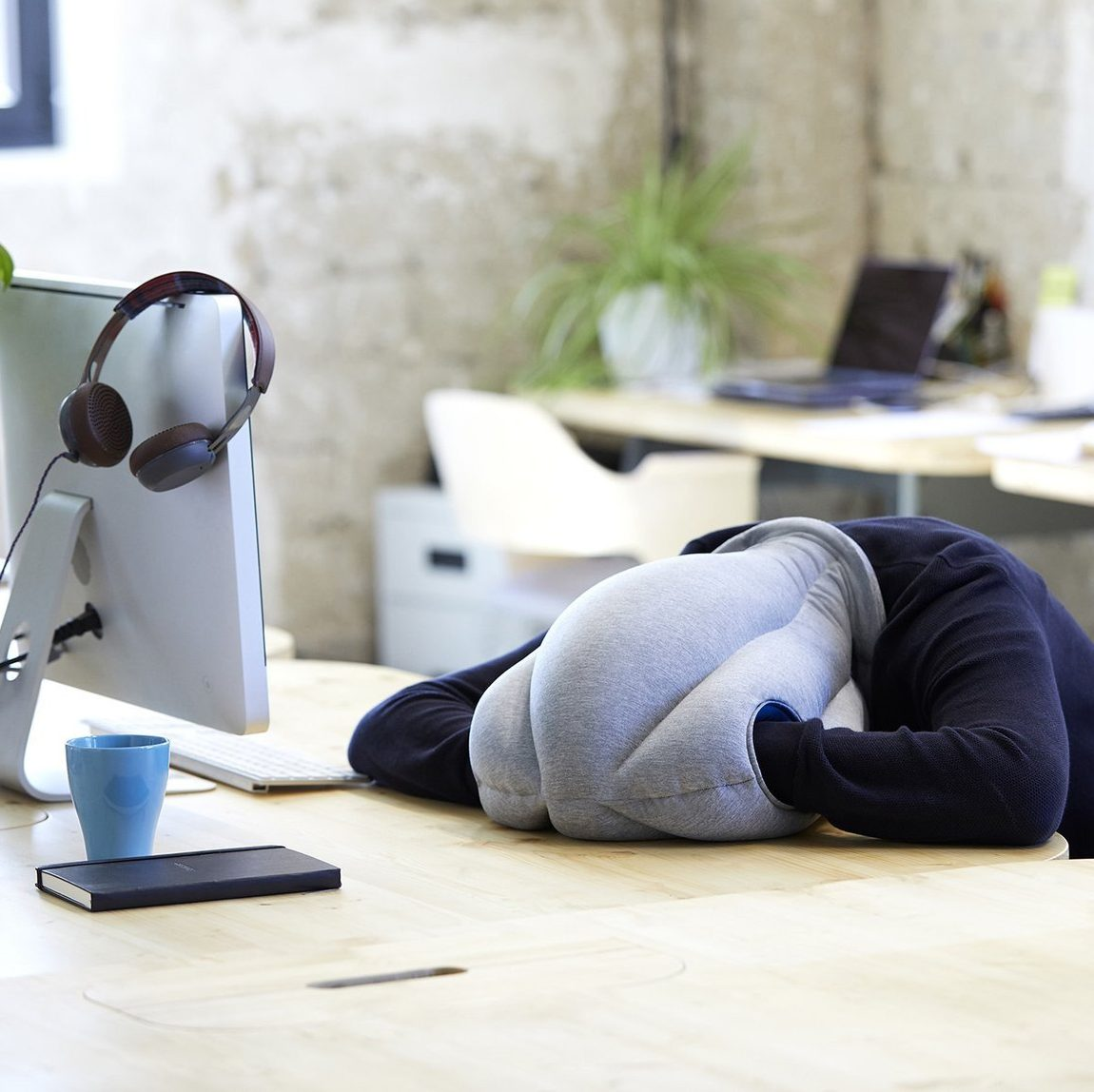 funny ostrich pillow is a great workaholic gift that allows for naps at work